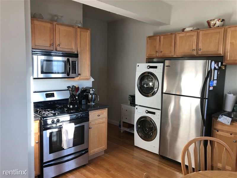 small kitchen and laundry units in an apartment